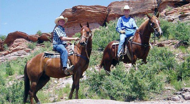 Horseback riding to Eagle Ridge under the Colorado rimrock.