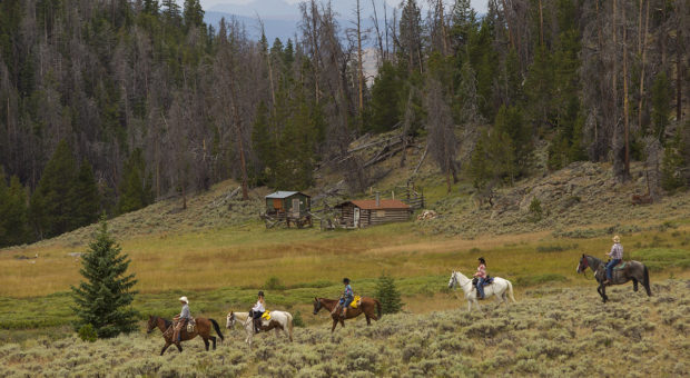 Clients enjoy a ride in the high mountains at the Lazy L & B Ranch, Dubois, Wyoming